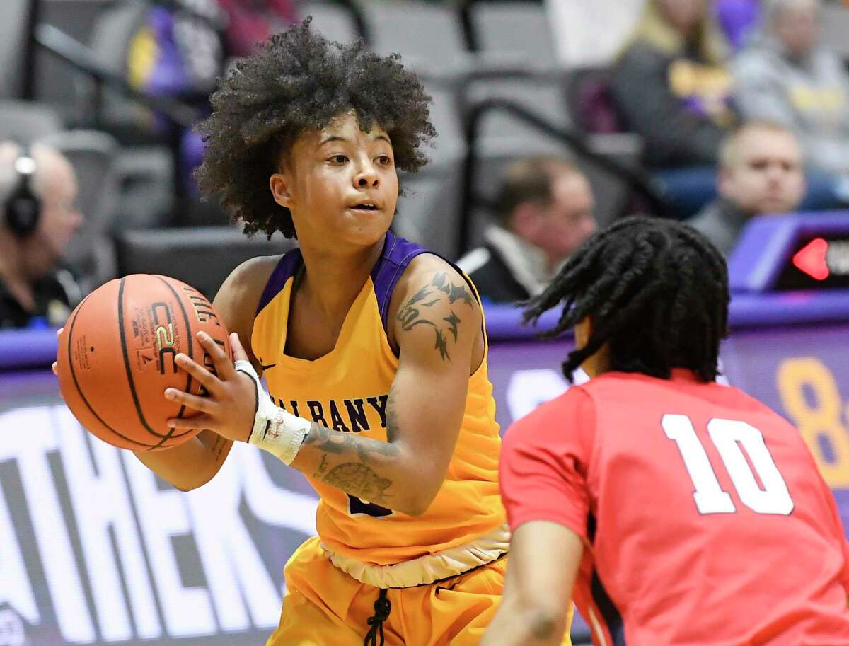 University at Albany guard Kyara Frames (2) moves the ball against Stony Brook guard Chantz Cherry (10)during the first half of an NCAA college basketball game Wednesday, Feb. 20, 2019, in Albany, N.Y. (Hans Pennink / Special to the Times Union)