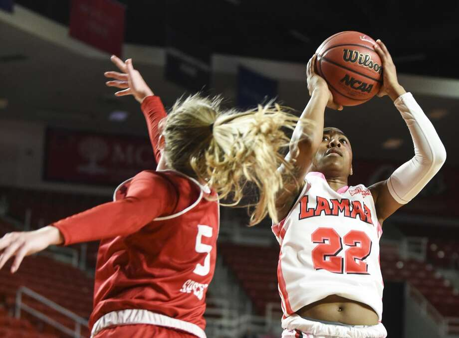 Lamar University's Miya Crump takes a shot while Incarnate Word's Kara Speer tries to block her during the first half of the game at Montagne Center on Wednesday night. Photo taken on Wednesday, 02/19/19. Ryan Welch/The Enterprise Photo: Ryan Welch/The Enterprise