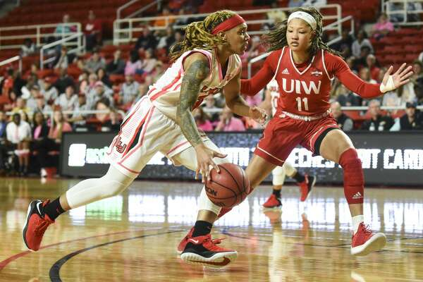 Lamar University's Moe Kinard dribbles the ball down the field as she tries to get past Incarnate Word's Imani Robinson during the first half of the game at Montagne Center on Wednesday night. Photo taken on Wednesday, 02/19/19. Ryan Welch/The Enterprise