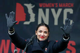 U.S. Rep. Alexandria Ocasio-Cortez waves to the crowd after speaking at Women's Unity Rally. Democrats, including Ocasio-Cortez of New York and veteran Sen. Ed Markey of Massachusetts, are calling for a Green New Deal intended to transform the U.S. economy to combat climate change and create jobs in renewable energy.
