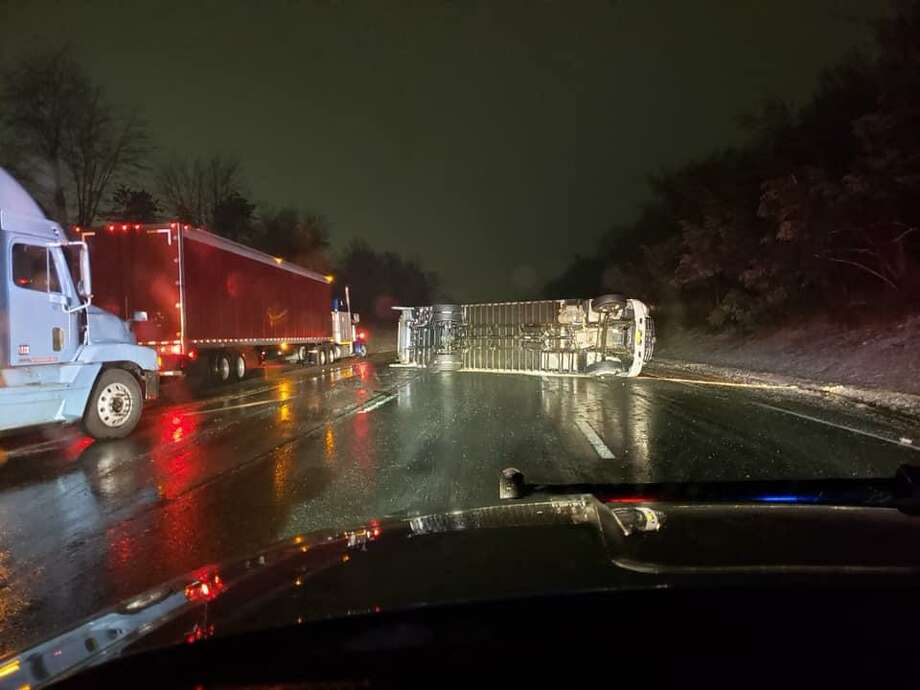 I-91 north in Middletown was shut down on Thursday, Feb. 231, 2019 aftrer a truck rolled over blocking the entire highway. The operator has non-life threatening injuries. The truck was carrying food. Photo: State Police Photo