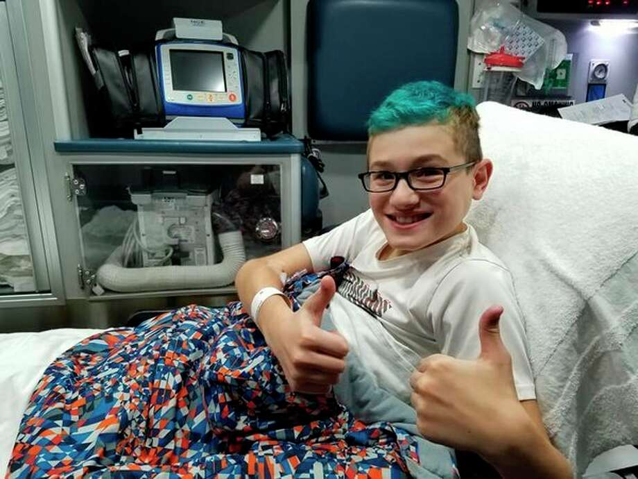 Deacon Orlowski, 12, gives a thumbs up to his friends and family, letting them know he is OKas he rides toC.S. Mott Children's Hospital in Ann Arbor in an ambulance. (Photo provided)