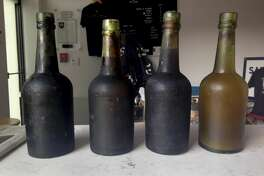 In this July 17, 2017 photo provided by Jamie Adams, four bottles recovered from the SS Oregon, a 133-year-old shipwreck, are shown at the Saint James Brewery in Holbrook, N.Y. Bill Felter of Serious Brewing in Howes Cave, N.Y., hoped to develop a new brew from ale salvaged from the SS Oregon. But the scuba-diving Long Island brewer, Adams, has scuttled those plans, saying he owns the shipwreck yeast and has used it to produce ale he's releasing in March 2019. (Jamie Adams via AP)