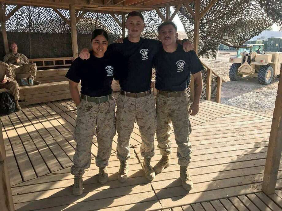 U.S. Marines serving in the Middle East, including Sgt. Martina E. Perrorazio, who is related to a Greenwich firefighter, are wearing Greenwich Fire Department T-shirts. The Greenwich Fire Department Local 1042 sent care packages to some U.S. Marines with money raised from Red Shirt Fridays campaign. Photo: Contributed /
