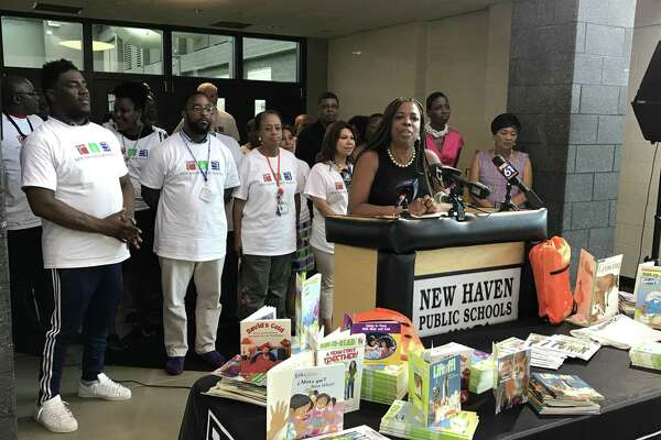 Gemma Joseph Lumpkin, chief of Youth, Family and Community Engagement for New Haven Public Schools, addresses the media during a community canvass to encourage school attendance.