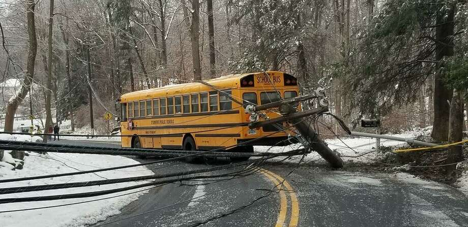 A Stamford school bus slid on an ice patch and struck a pole, draping power wires over the body of the vehicle on Thursday morning in North Stamford on Feb. 21, 2019. Photo: Stamford Police / Contributed