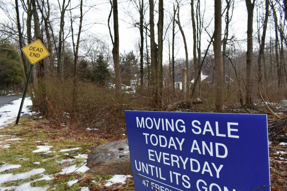 A moving sale sign in mid-February 2019 in Norwalk, Conn. The month before, real estate listings rose in southwestern Connecticut, with some homeowners possibly looking to downsize or relocate after seeing their IRS bills spike with a $10,000 cap on deductions for state and local taxes. Photo: Alexander Soule / Hearst Connecticut Media / Stamford Advocate