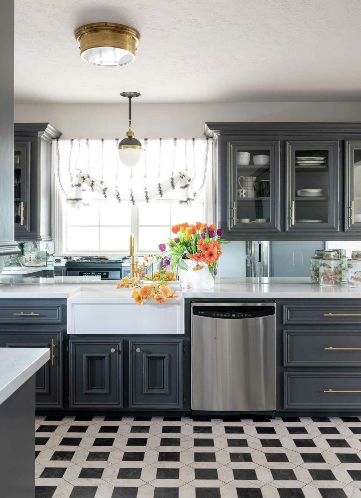 There are plenty of things you can do to spruce up small kitchens. Old cabinets can be painted, and new hardware added. You can also swap out wood panels for glass ones in cabinets where you want to show of pretty dishes or barware. (Room by Renea Abbott of Shabby Slips)