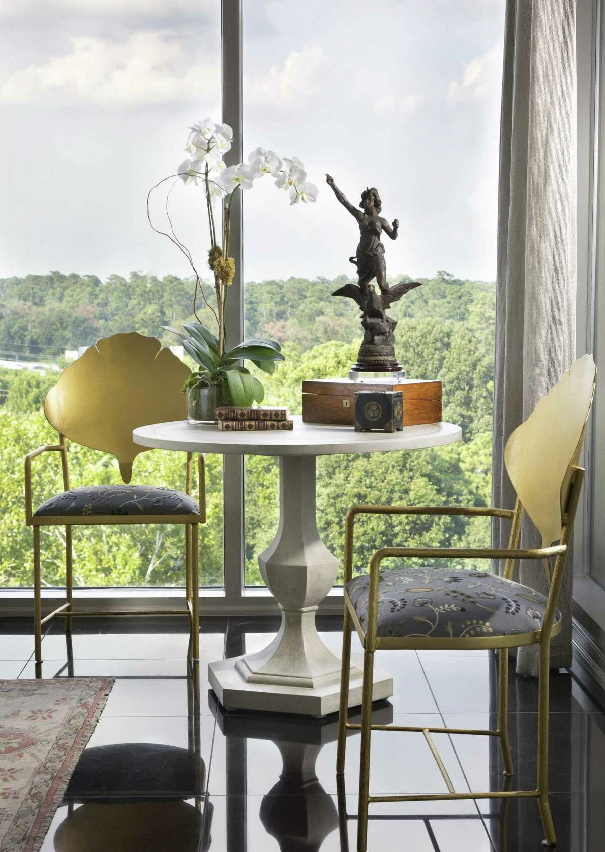 In a large room, create a second smaller seating area, like this corner nook with two chairs and a small table. (Room by Connie LeFevre of Design House)