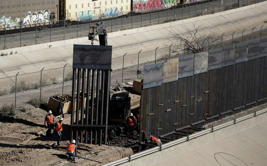 Workers expand sections of metal wall near downtown El Paso last month, work funded by Congress. The president's attempt to circumvent Congress' power of the purse is doomed to fail. Photo: Eric Gay /Associated Press / Copyright 2019 The Associated Press. All rights reserved.