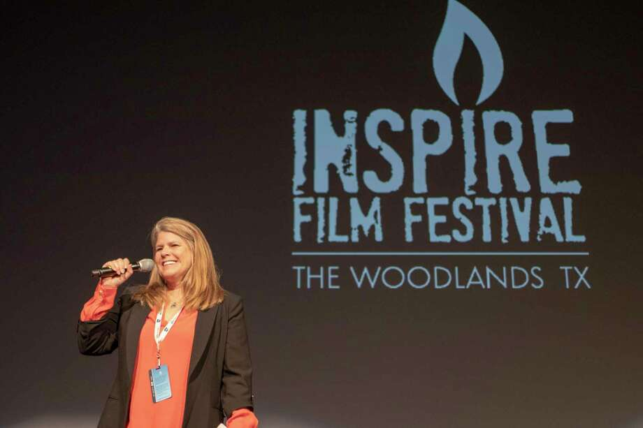 Inspire Film Festival founder Jane Minarovic addresses a crowd during the Inspire Film Festival on Thursday, Feb. 14, 2019 in The Woodlands. The 2020 Inspire Film Festival is just around the corner, and officials with The Woodlands one-and-only film festival have a stellar line-up on tap for the fourth year of the event, which attracts actors, directors and filmmakers to the township for four days of movies, education, panel discussions and other special events. Photo: Cody Bahn, Houston Chronicle / Staff Photographer / © 2018 Houston Chronicle