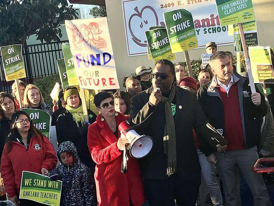Keith Brown, president of the Oakland Education Association, addresses the crowd at Manzanita Community School on the first day of the teachers' strike. Photo: Ashley McBride, The Chronicle