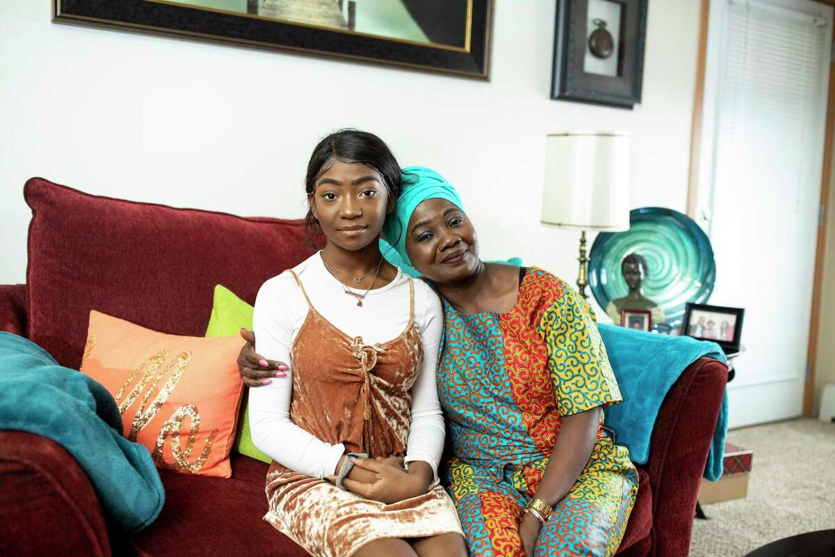 Magdalene Menyongar and her daughter, Gabby, in their home in Maple Grove, Minn., on Feb. 3, 2019.