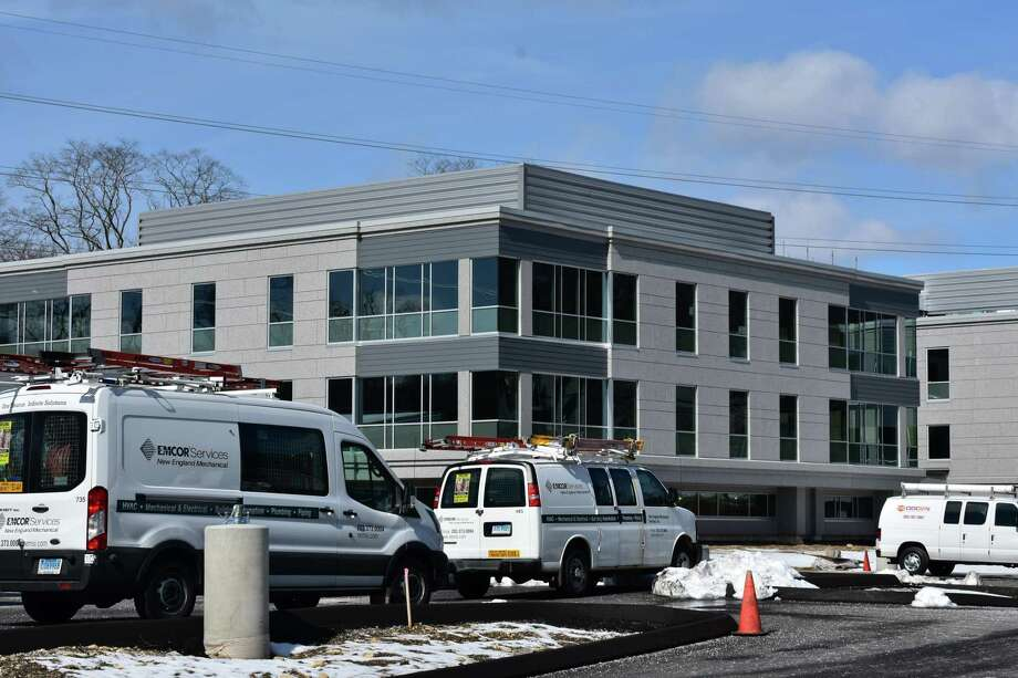 Service vans of Emcor Group in mid-March 2018 at Wilton Wellness Center under construction at the time at 249 Danbury Road in Wilton, Conn. Photo: Alexander Soule / Hearst Connecticut Media / Stamford Advocate