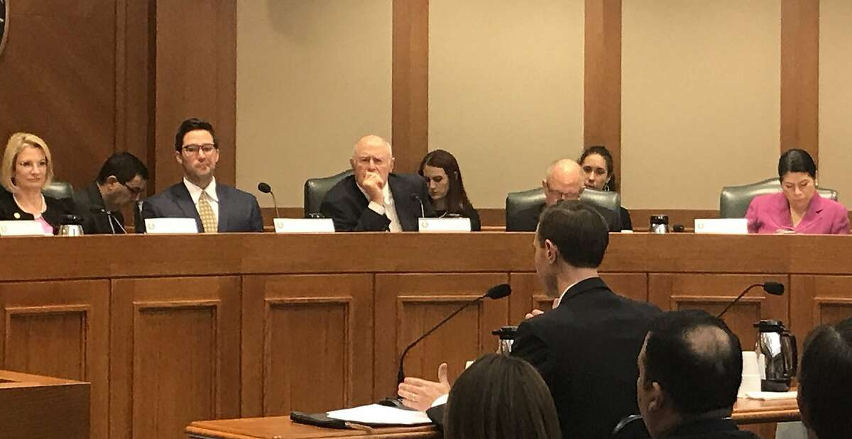 Texas Secretary of State David Whitley, in foreground, testifies before the Senate Nominations Committee abouttheanalysis by his office that fueled aneffort to purge tens of thousands of suspected non-citizens from the Texas voter rolls.