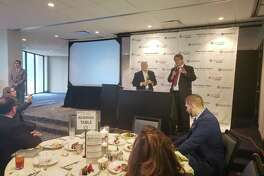 Texas District 8 Congressman Kevin Brady (left) and Greater Houston Partnership's senior vice president of research Patrick Jankowski (right) talk about the U.S, economy and the positive impact it has on Houston's economy at the Economic Outlook Luncheon on Feb. 19, 2019.