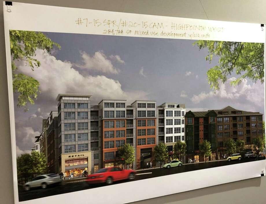 A rendering of the planned Highpointe West Development hangs in Norwalk City Hall. Photo: Kelly Kultys / Hearst Connecticut Media / Norwalk Hour