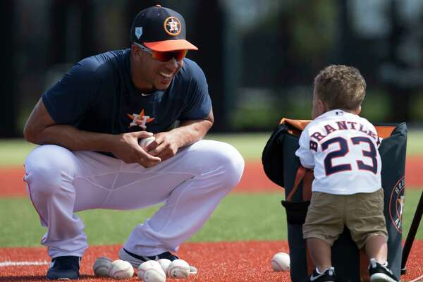 Houston Astros left fielder Michael Brantley plays with his one-year-old son, Maxwell, after practice at Fitteam Ballpark of The Palm Beaches on Day 8 of spring training on Thursday, Feb. 21, 2019, in West Palm Beach.