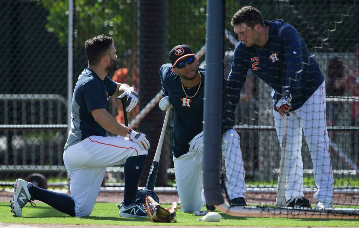 Houston Astros third baseman Alex Bregman (2) talks to Jose Altuve, left, and Yuli Gurriel after a round of battting pratice at Fitteam Ballpark of The Palm Beaches on Day 8 of spring training on Thursday, Feb. 21, 2019, in West Palm Beach.