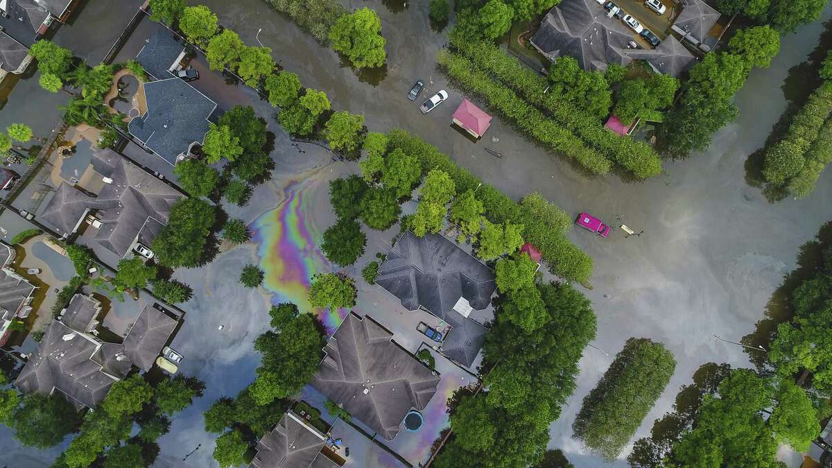 Homes in the Canyon Gate area of Cinco Ranch are surrounded by water from Barker Reservoir, Saturday, September 2, 2017, in Houston. (Mark Mulligan / Houston Chronicle)