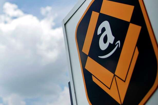 The Amazon.com logo is displayed outside the company's fulfillment center in Kenosha, Wis.