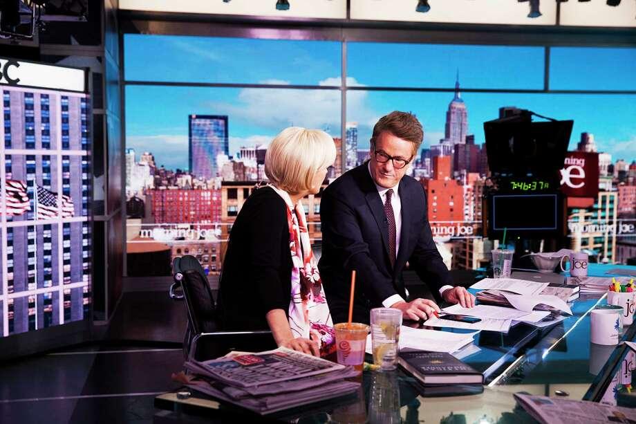 "Joe Scarborough, right, of MSNBC's ""Morning Joe"" on set with co-host Mika Brzezinski in December 2016. Photo: Photo For The Washington Post By Jesse Dittmar / Jesse Dittmar"