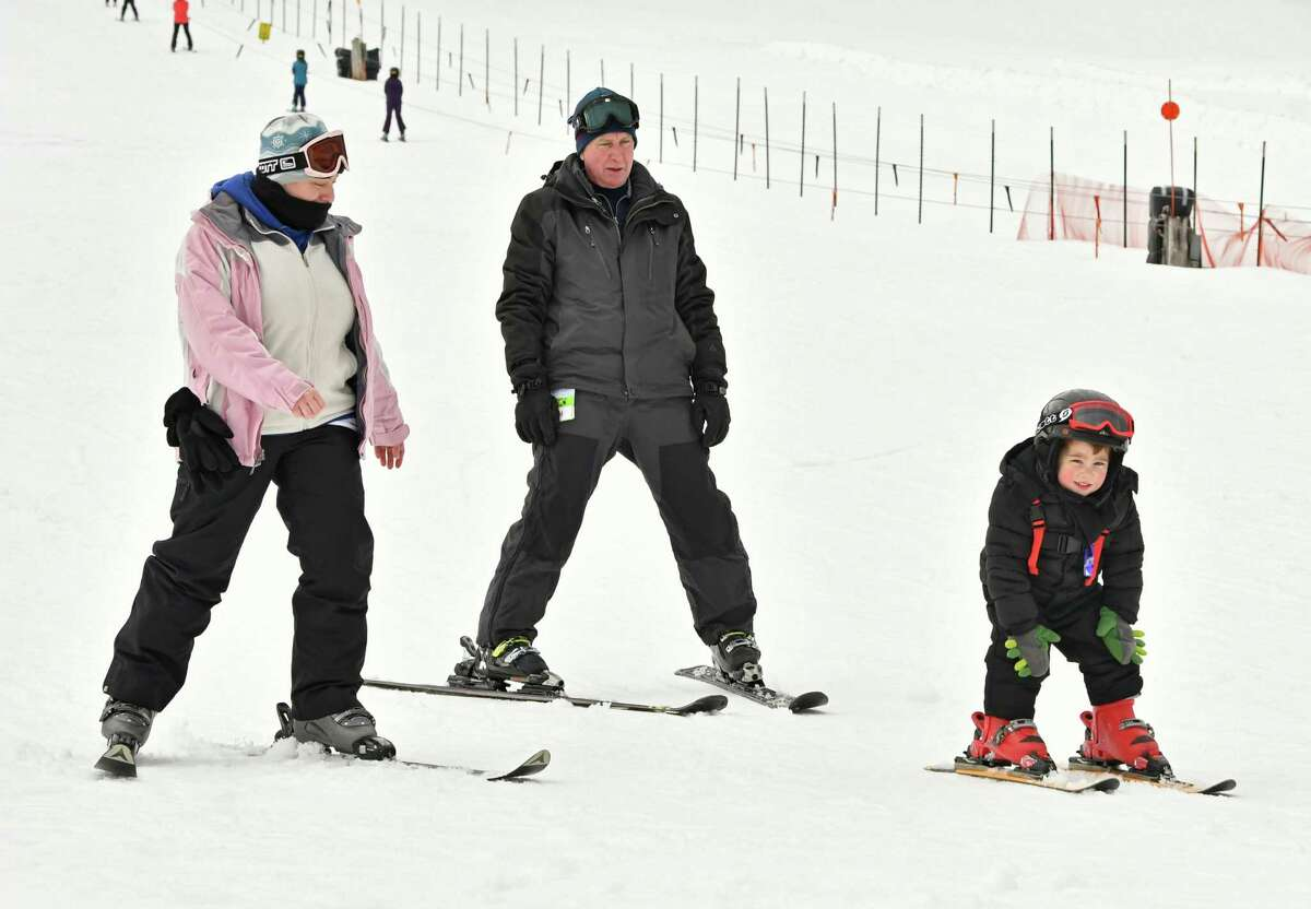 Vincent Abbruzzese, 3, of Guilderland is followed by his mom Kourtney Abbruzzese, left, and his grandfather Dwight LaDu as he skies down a slope at Maple Ski Ridge on Thursday, Feb. 21, 2019 in Schenectady, N.Y. (Lori Van Buren/Times Union)