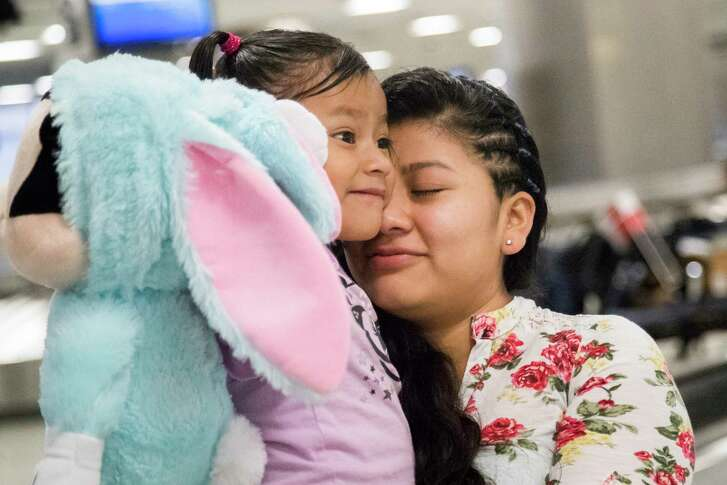 Guatemalan mother Sara Caal presses her 5-year-old daughter's cheek against her as they reunite on Thursday at the George Bush Intercontinental Airport in Houston on Feb. 21, 2019. Caal and her daughter Alida were separated at the Texas-Mexico border last summer.