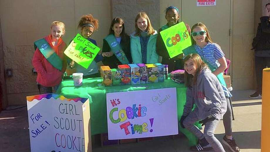 Members of Girl Scout Troop #972 from Edwardsville and Glen Carbon selling Girl Scout Cookies earlier this year. Photo: Photo Courtesy Of Erin Johnson