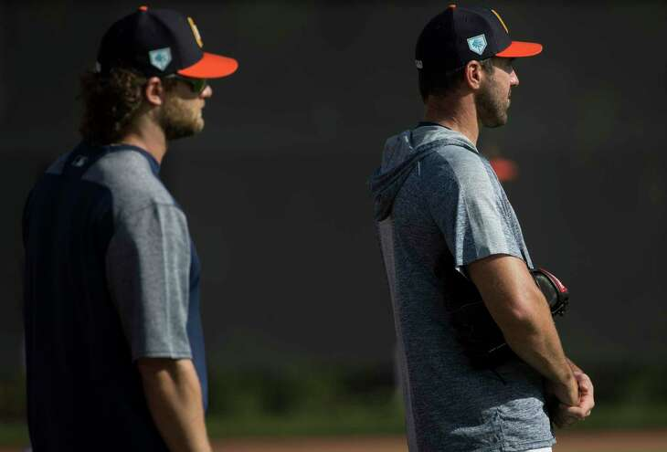 Houston Astros right handed pitcher Gerrit Cole, left, and Justin Verlander watch pitchers warm up at Fitteam Ballpark of The Palm Beaches on Day 8 of spring training on Thursday, Feb. 21, 2019, in West Palm Beach.