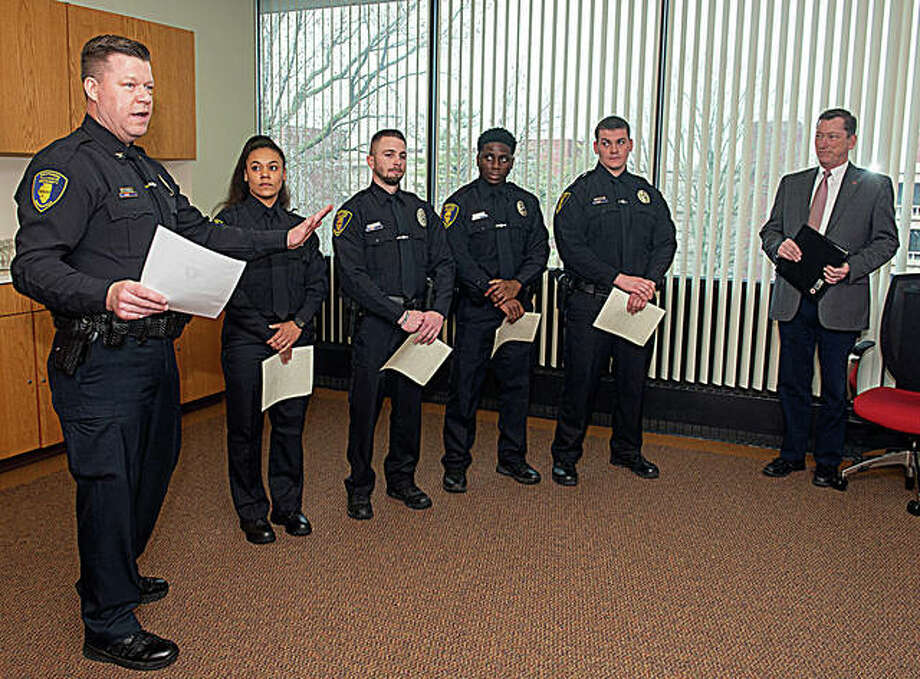Photo (L-R): SIUE Chief of Police Kevin Schmoll, officers Samantha Jones, Jeff Wooldridge, Darius Smith and Shane Mason, and Vice Chancellor for Administration Rich Walker. Photo: For The Intelligencer