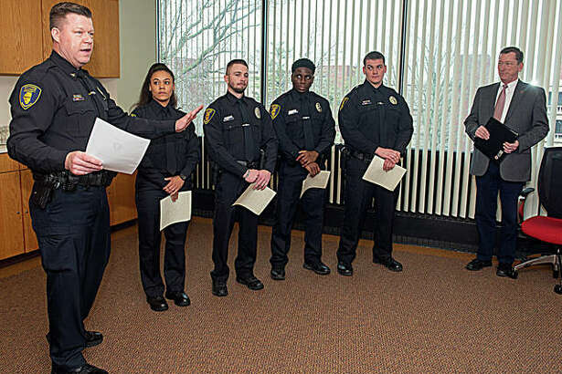 Photo (L-R): SIUE Chief of Police Kevin Schmoll, officers Samantha Jones, Jeff Wooldridge, Darius Smith and Shane Mason, and Vice Chancellor for Administration Rich Walker.