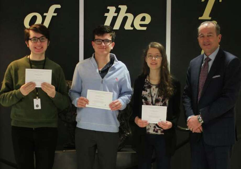 Ryan Ash, Christopher Byron, and Adrienne Rose receive their 2019 National Merit Scholarship Program Finalists certificates from EHS Principal Dr. Dennis Cramsey. Photo: For The Intelligencer