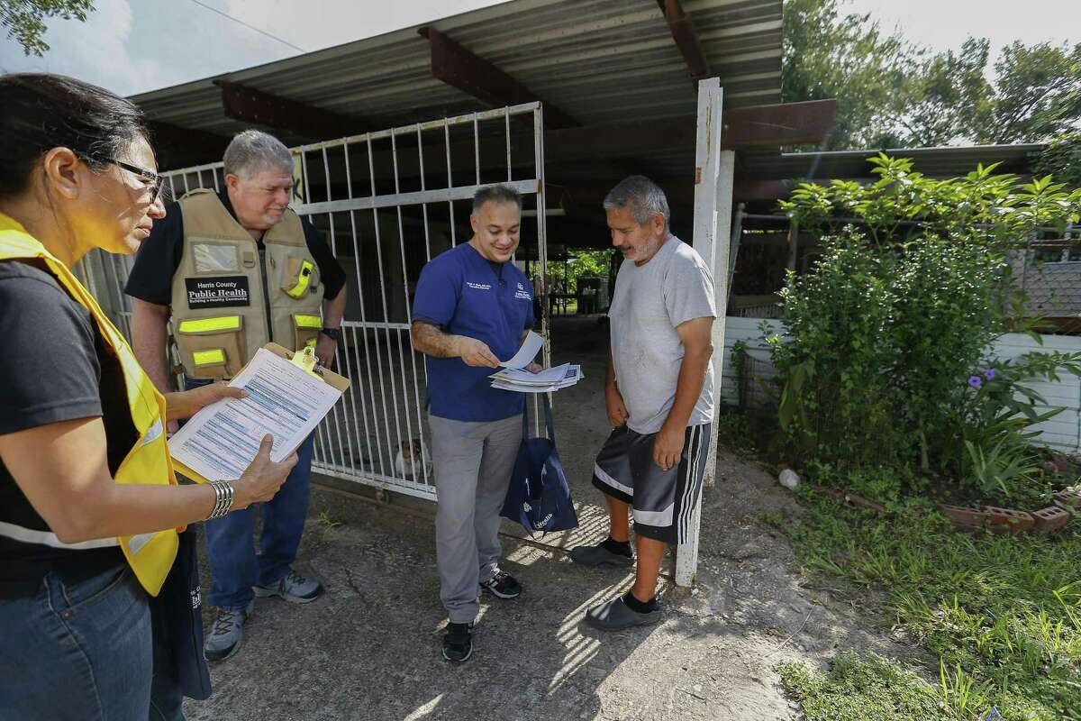 Harris County Public Health (HCPH) Martha Marquez (left-right), Mac McClendon and Dr. Umair A. Shah, MD talk with Hurricane Harvey victim Juan Cazares as staff and volunteers revisited the Aldine community Saturday, Sept. 8, 2018, in Houston. HCPH staff and volunteers assess their needs one year after Hurricane Harvey. The results will be shared with local, state and federal public partners to better understand how residents were impacted, what their current needs are and how to better prepare residents for future emergencies.