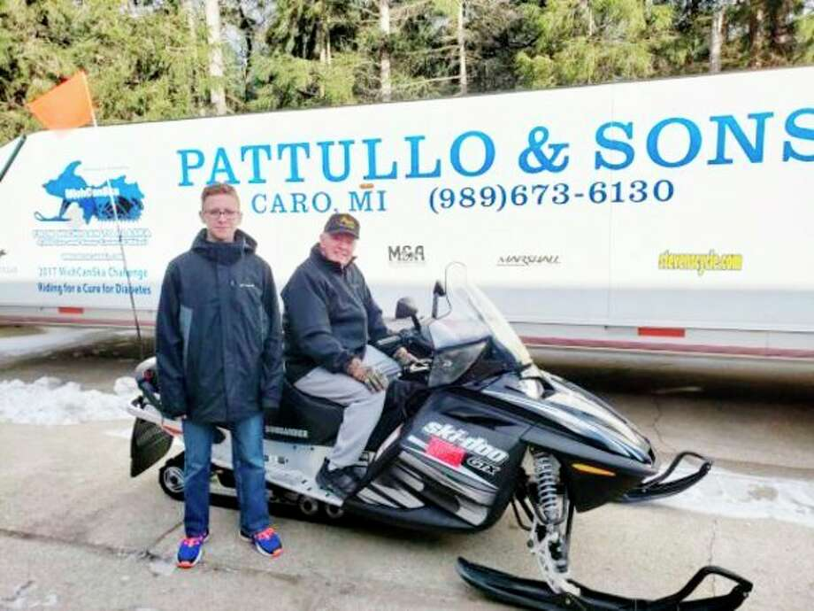 From left, Matthew Pattullo and his grandfather, George Pattullo, will begin their 1,000-mile snowmobile ride to Ontario, Canada, on Saturday with other family members and friends. The annual trek is a fundraiser. The Pattullo family has been snowmobiling for charities for many years, and this will be Matthew's first adventure. (Courtesy Photo)