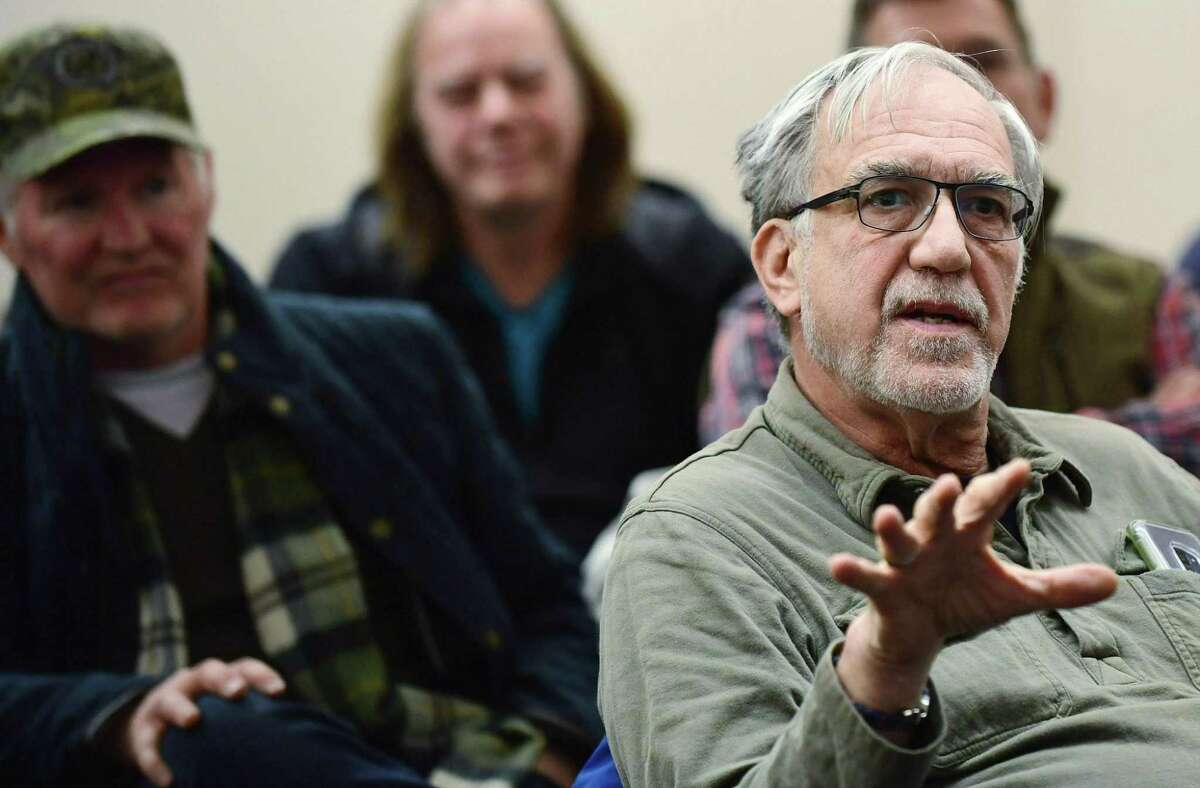 Norwalk resident Alan Kibbe speaks during an informational session presented by The Norwalk Parking Authority Wednesday, February 20, 2019, at the Yankee Doodle Garage conference room about its plans to add angled parking at Wall St and several nearby roads in Norwalk, Conn.