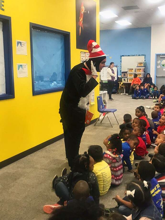 Main Street Theater's Jonathan Teverbaugh reads and listens as the Cat in the Hat. Photo: Courtesy Of Main Street Theater