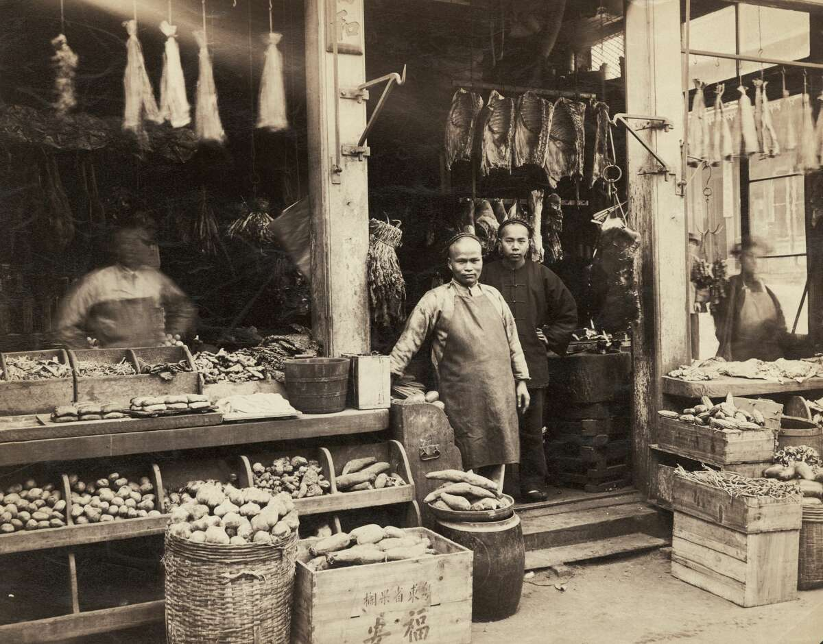 A Chinese butcher and grocery store, San Francisco, California, circa 1885.