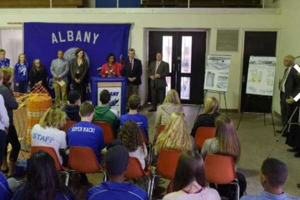 Kimberly Young Wilkins, at podium, interim Albany School District superintendent, addresses those gathered at a groundbreaking ceremony for Albany High SchoolOs pool building on Tuesday, Oct. 25, 2016,