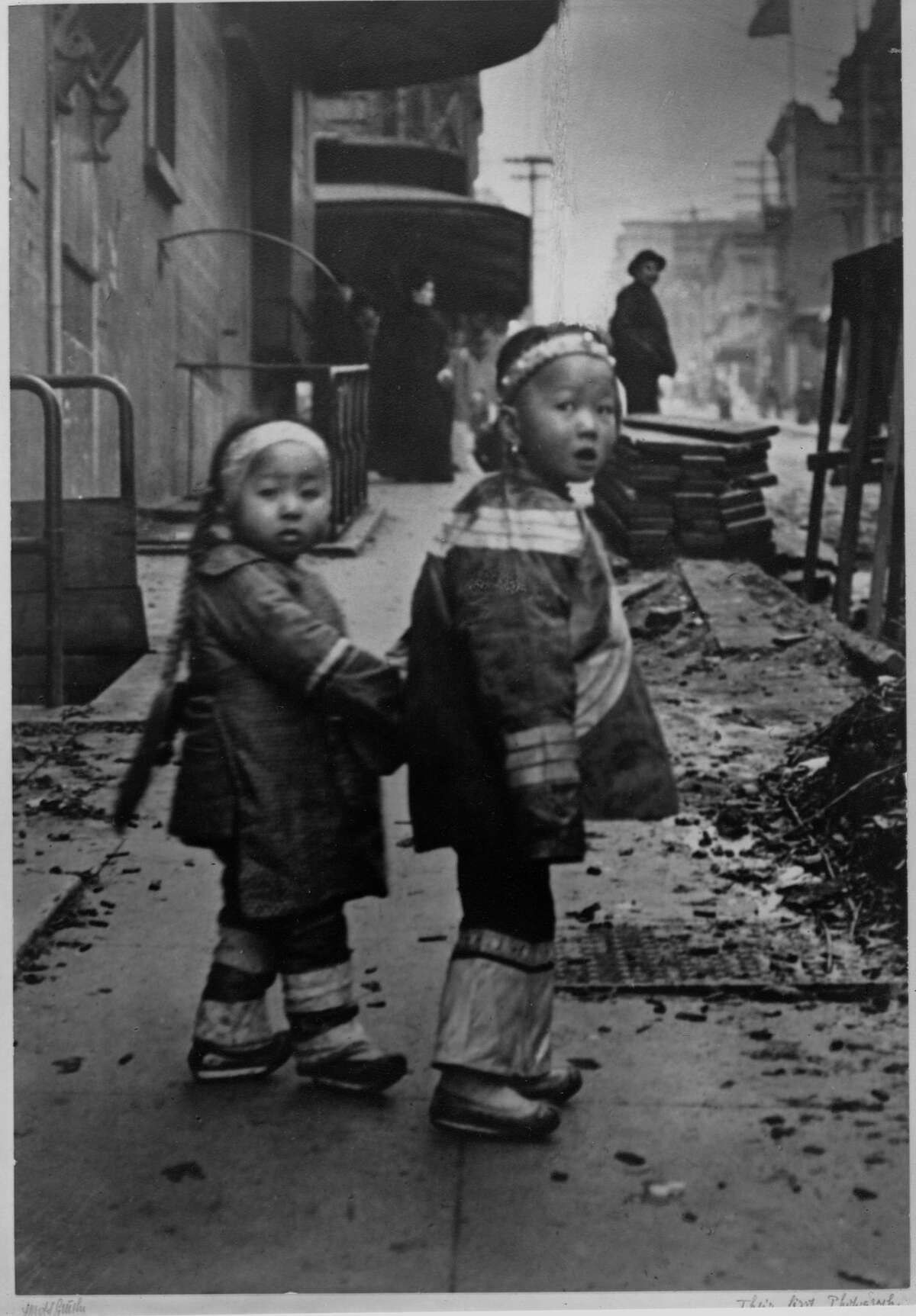 Historic photos of SF Chinatown before the 1906 earthquakeTwo little sisters hold hands as they walk down the street in Chinatown, San Francisco, ca. 1890s.