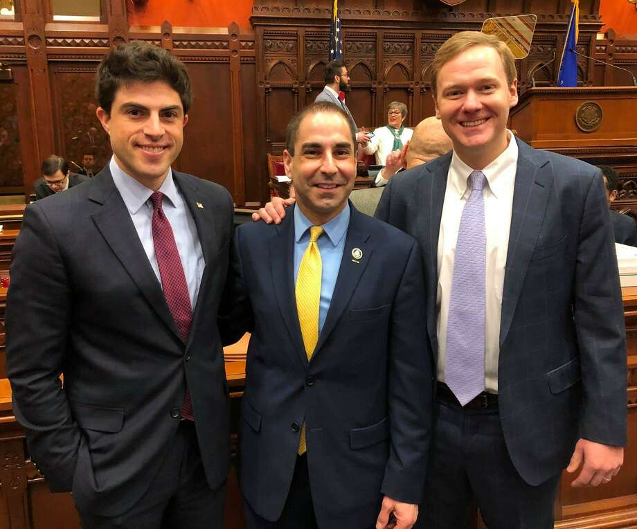 State Rep. Matt Blumenthal, Veterans Affairs Commissioner Tom Saadi and House Majority Leader Matt Ritter posed after lawmakers voted unanimously to confirm Saadi this week. Photo: Contributed Photo / Tom Saadi