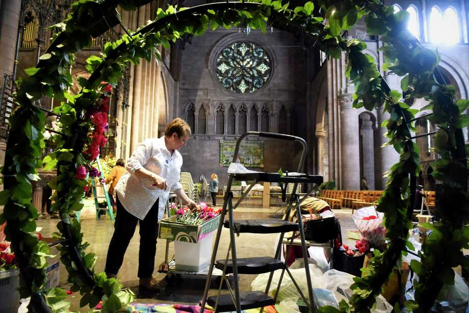 Michele Peters, owner of Ambiance Floral in Albany, works creating a floral design during set up for the inaugural Cathedral in Bloom at the Cathedral of All Saints on Thursday, Feb. 21, 2019, in Albany, N.Y. Thirty florists are taking part in the show, which opens on Friday at 10am. The show runs Friday from 10:00 am to 4:00 pm and then a champagne gala at 7:00 pm Friday. The show continues on Saturday from 10:00 am to 6:00 pm, and Sunday from noon to 4:00 pm. The show will have workshops and presentations by the regionÕs florists, a public flower market, an organ recital, and a lunch cafe.    (Paul Buckowski/Times Union) Photo: Paul Buckowski, Albany Times Union / (Paul Buckowski/Times Union)
