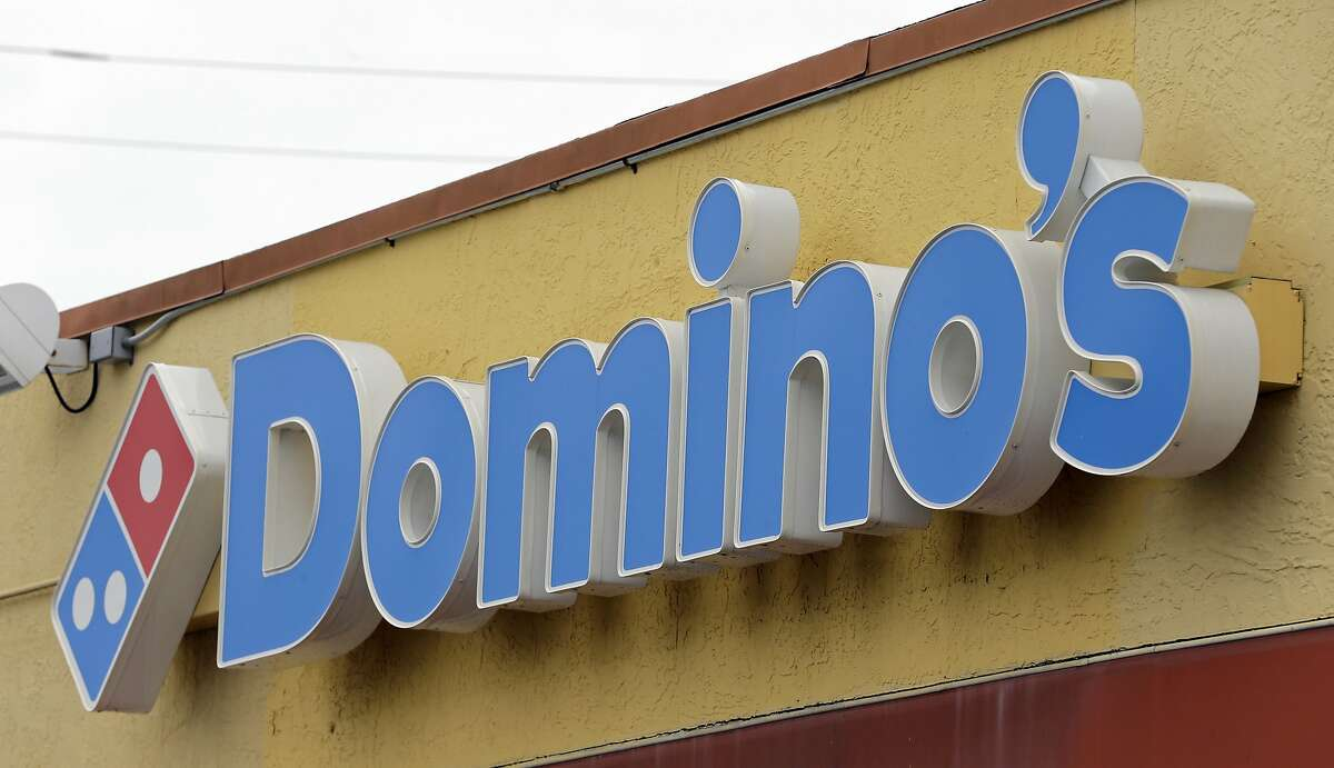 FILE - This Thursday, Oct. 27, 2016, photo shows a Domino's Pizza sign at a location in Hialeah, Fla. Domino's Pizza Inc. on Thursday, Feb. 21, 2019 reported fourth-quarter earnings of $111.6 million. On a per-share basis, the Ann Arbor, Michigan-based company said it had net income of $2.62.(AP Photo/Alan Diaz, File)