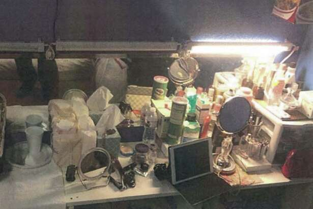 The inside of an alleged brothel in Dallas shows a cramped counter with beauty products on hand.