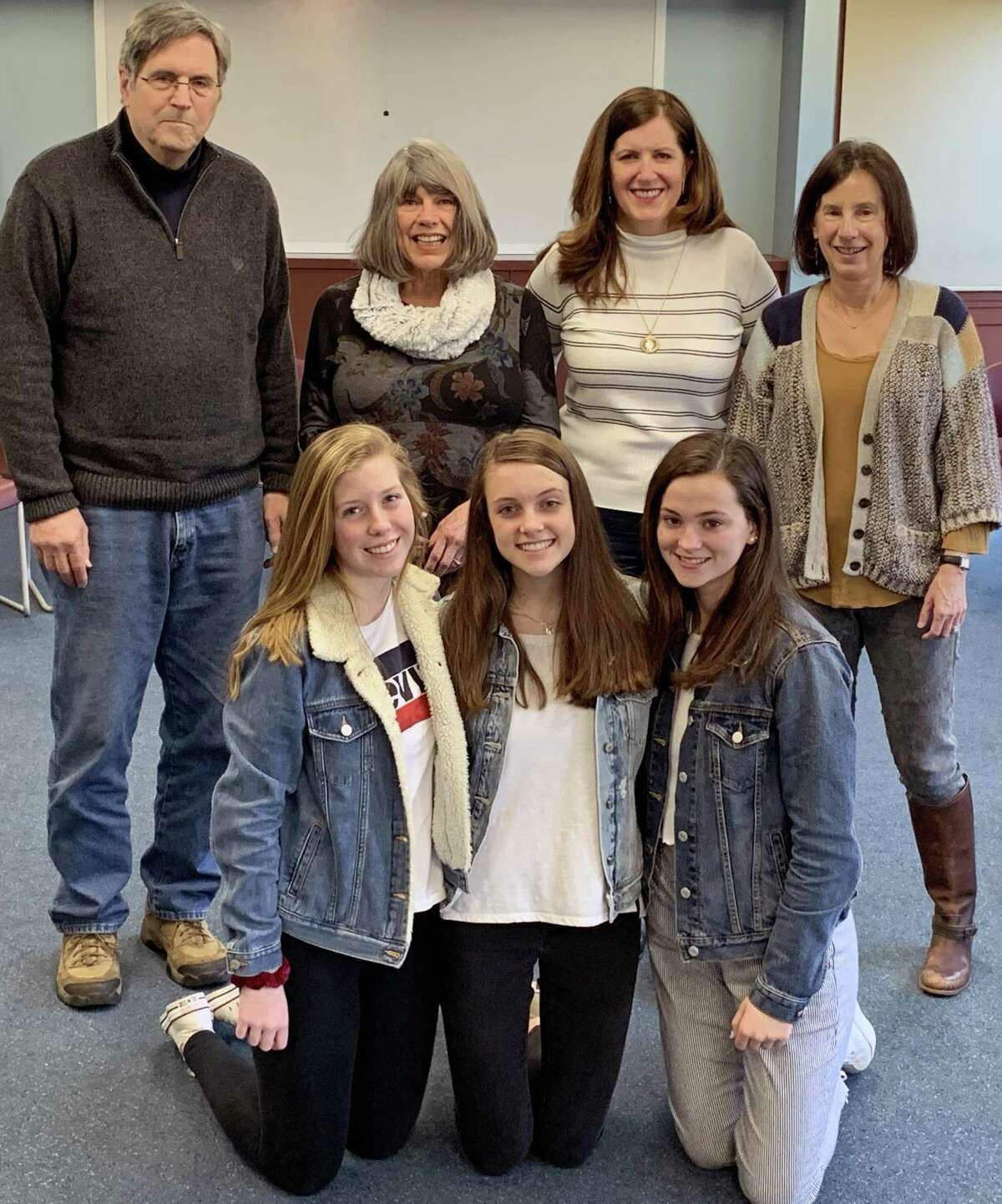 Standing are member of Families Helping Families, (left to right President Miner Vincent, Vice President/Secretary Lynn Hidek and Board Members Eileen Smith and Nancy Stone, along with Morgan School students, kneeling (left to right), Emma Lindsay, Abby Eydman and Clara Franzoni.