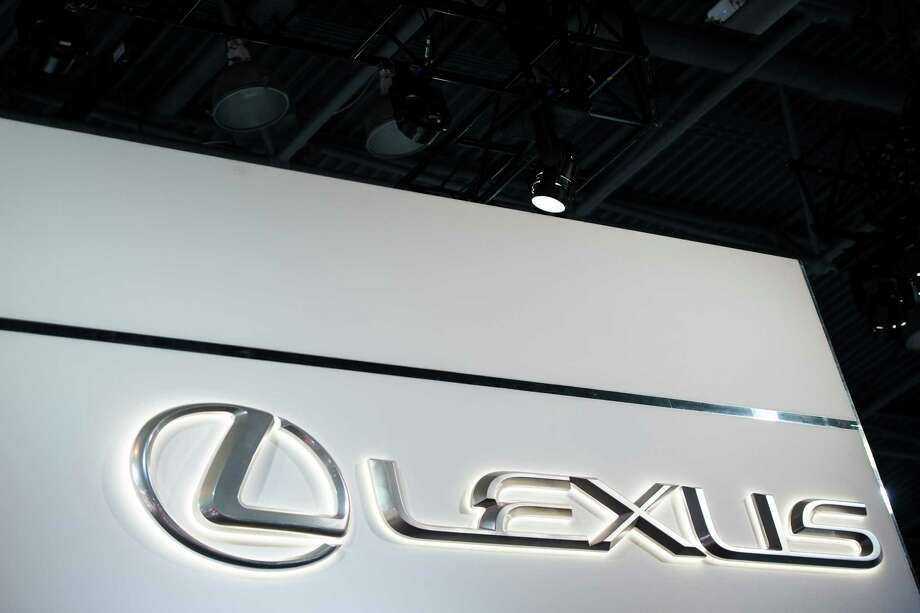 FILE: Toyota Motor Co. Lexus signage is displayed during the 2017 New York International Auto Show (NYIAS) in New York, U.S., on Thursday, April 13, 2017. For BMW AG, Tesla Inc. and other global automakers whose future is ever-more dependent on China?s burgeoning market, any gains from lower import tariffs this week will likely be short-lived -- thanks to President Donald Trump?s trade war. Unless President Trump backs down, on July 6 the U.S. will impose tariffs on $34 billion of Chinese imports, many of them parts used in products such as marine engines and power turbines. China will impose countervailing levies the same day -- including on U.S.-manufactured cars. Our editors select archive images of the leading brands affected by the trade war. Photographer: Mark Kauzlarich/Bloomberg Photo: Mark Kauzlarich / © 2018 Bloomberg Finance LP