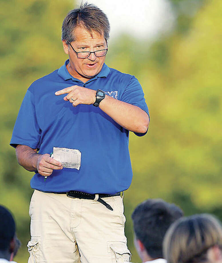 Joe Burchett has stepped down after two seasons as head coach of the boys soccer team at Marquette Catholic High. Burchett guided the Explorers to the 2017 Class 1A state championship and was 33-9-7 in two seasons. Photo: Billy Hurst File Photo | For The Telegraph