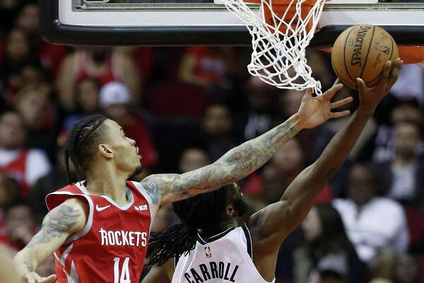 Houston Rockets guard Gerald Green (14) defends a shot by Brooklyn Nets forward DeMarre Carroll (9) during the second half of an NBA basketball game at Toyota Center on Wednesday, Jan. 16, 2019, in Houston.