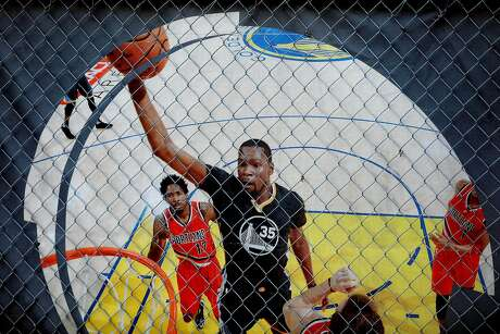 An image of Golden State Warriors forward Kevin Durant is posted outside the Chase Center, under construction in San Francisco's Mission Bay. Photo: Yalonda M. James / The Chronicle