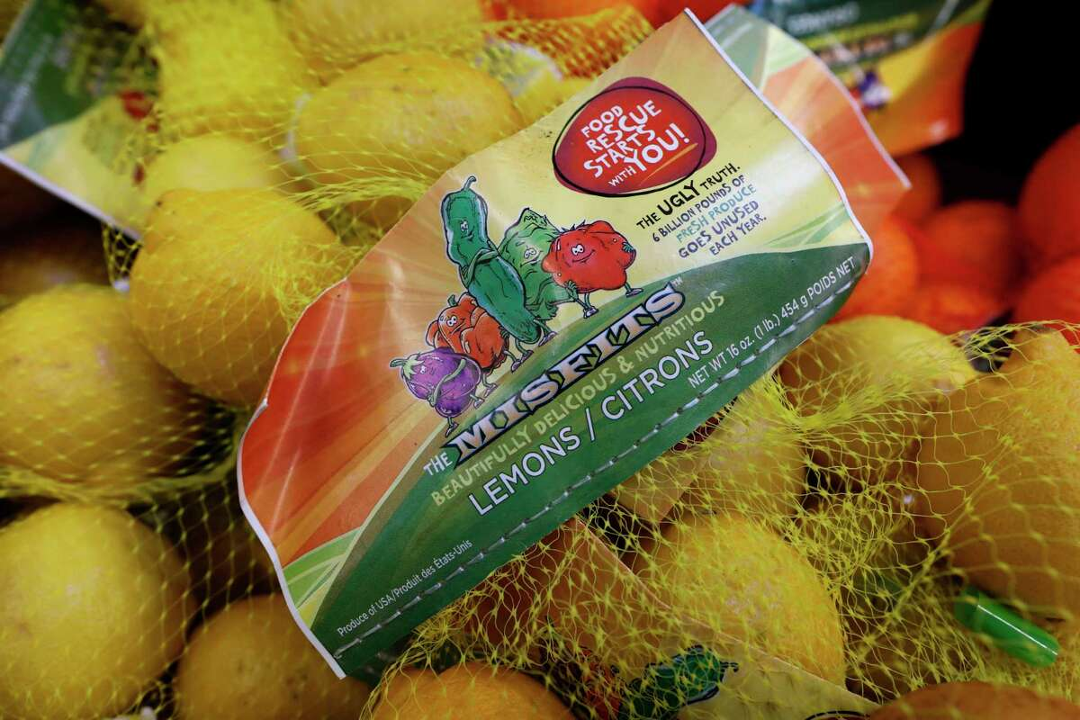 Some stores and home delivery startups haven?'t given up on the idea of selling less-than-perfect produce to reduce food waste. (AP Photo/Charlie Neibergall)